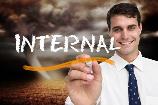 Businessman writing the word internal