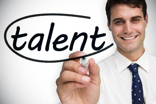 Businessman writing the word talent