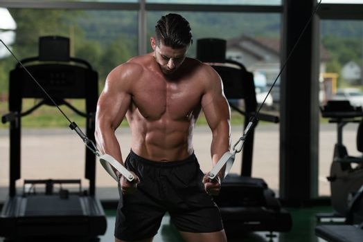 Bodybuilder Is Working On His Chest With Cable Crossover In Gym