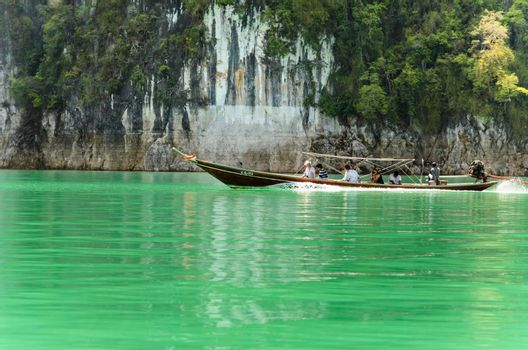 SURAT THANI, THAILAND - APRIL 26, 2013 : The tourists on the boat are travel around Ratchaprapha Dam in Khao Sok National Park, APRIL 26, 2013 in Thailand