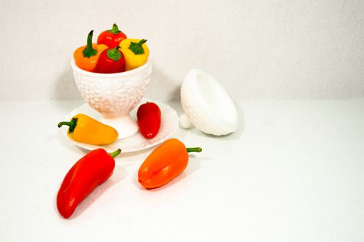 Colorful Peppers in a Milk Glass Bowl on White Background