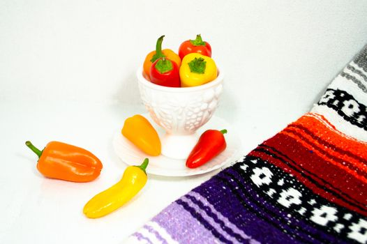 Colorful Peppers in a Milk Glass Dish with Mexican Blanket