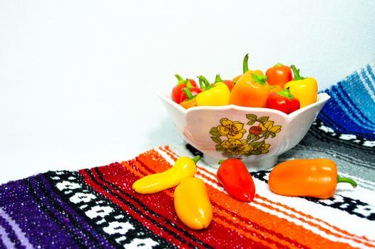 Colorful Peppers in a Bowl with a Mexican Blanket