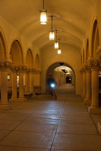 Bicyclist In Arched Passageway