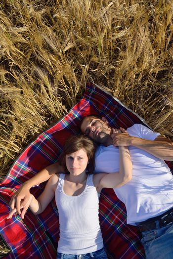 happy young couple in love have romance and fun at wheat field in summer