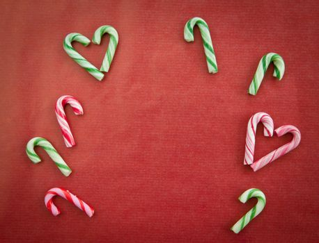Candy canes on red