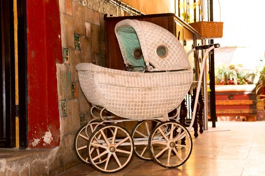 old fashioned stroller in vintage environment