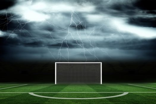 Football pitch under stormy sky