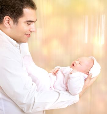 Happy father with newborn daughter
