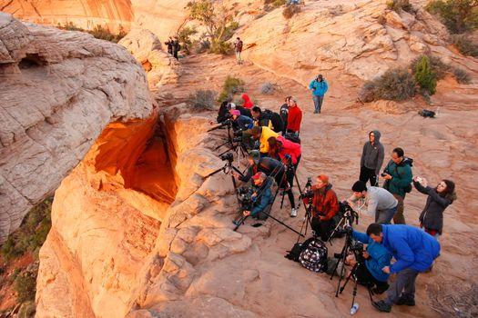 Photographers and tourists watching sunrise at  Mesa Arch, Canyo