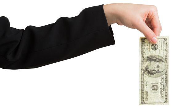 Businesswomans hand holding hundred dollar bill