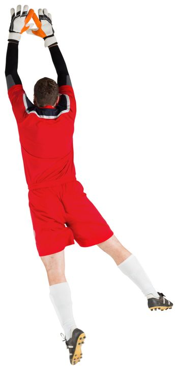 Goalkeeper in red jumping up