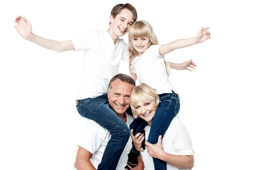 Playful family of four isolated over white
