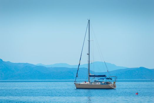 lone sailing yacht drifting in the sea