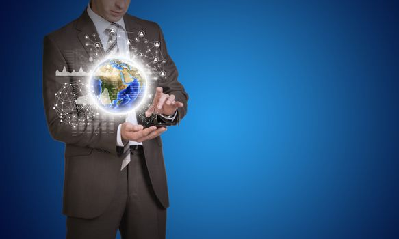 Businessman in suit hold empty copy space. Earth and network with people icons. Elements of this image are furnished by NASA