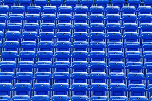 Empty Blue Bleachers Outdoors with Numbers - Nobody