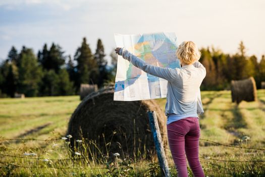 Lost Young Woman on a Rural Scene Looking at a Map