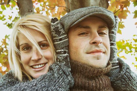 Young couple having some outdoor autumn fun