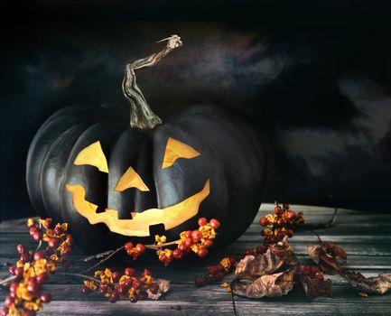 Spooky pumpkin on table
