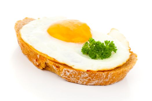 Fried eggs on crusty toasted bread