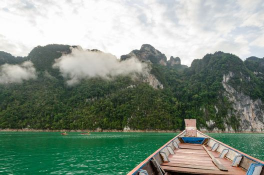 Travel by small boats in the morning at Ratchaprapha Dam, Khao Sok National Park, Surat Thani Province, Thailand