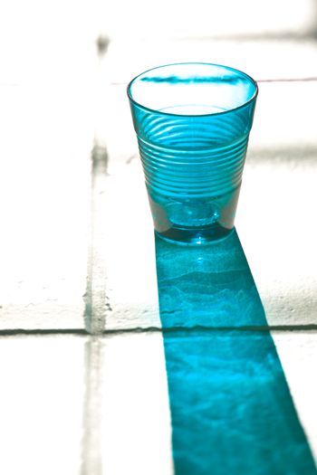 blue empty glass with reflection