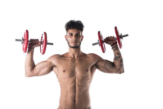 Handsome shirtless muscular young man exercises with dumbbells