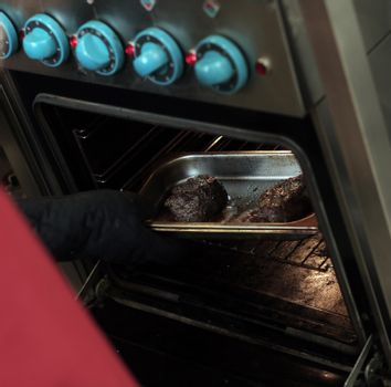 Meat is put in a stove