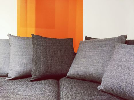Gray fabric sofa with cushions