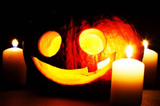 Halloween pumpkin and candles isolated on black background