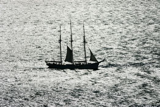 sail boat against the light