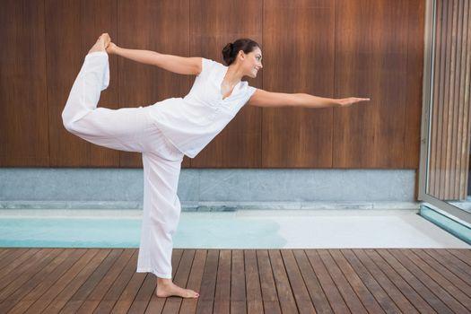 Content brunette in white in the shiva posture