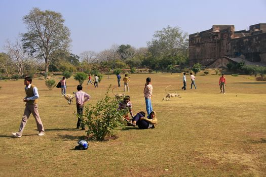Local teenagers playing in a field at Ranthambore Fort, India