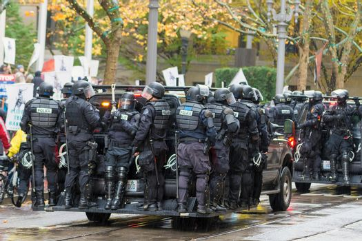 PORTLAND, OREGON - NOVEMBER 17, 2011: Police in Riot Gears on Vehicles in Downtown Portland, Oregon during a Occupy Portland Protest Against Banks on the first anniversary of Occupy Wall Street