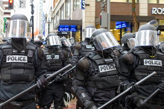 PORTLAND, OREGON - NOVEMBER 17, 2011: Portland Police in Riot Gear in Downtown Portland, Oregon Street during a Occupy Portland Protest Against Banks on the first anniversary of Occupy Wall Street