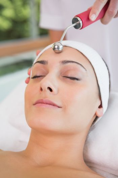 Peaceful brunette getting micro dermabrasion