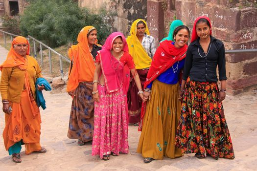 Indian women in colorful saris walking up the stairs at Ranthamb