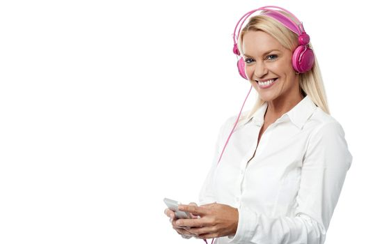 Woman with headphones and cell phone