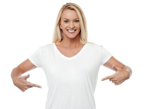 Smiling woman pointing her stomach