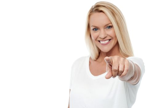 Happy woman pointing at you