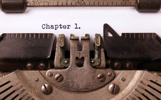 Vintage inscription made by old typewriter, chapter 1