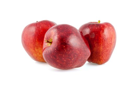 Three fresh red apples on a white background