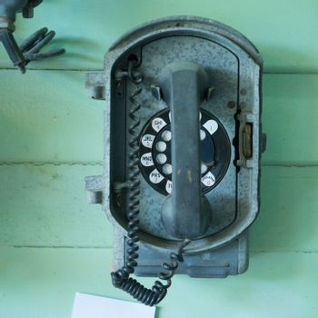 old-fashioned classic vintage telephone on the  wall