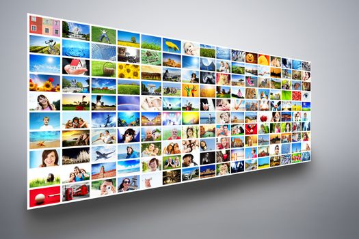 Pictures display on wide modern monitors, screens forming a multimedia broadcast