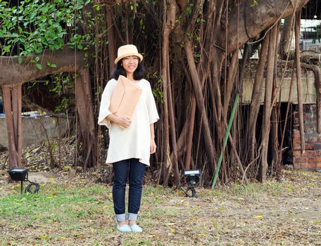 Young fashion girl with handbag