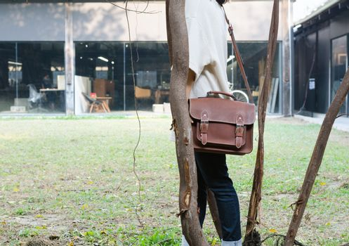 Woman with vintage leather bag