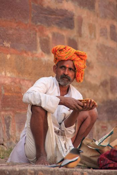 Indian man sitting at Ranthambore Fort, India