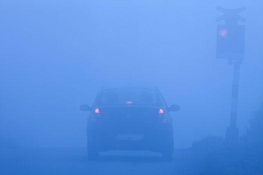 railroad crossing in fog