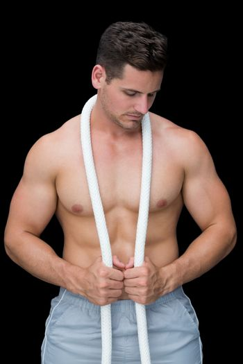 Strong crossfitter posing with rope around neck