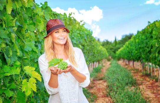 Happy woman on the vineyard